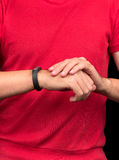 Athlete and fitness bracelet Royalty Free Stock Photography