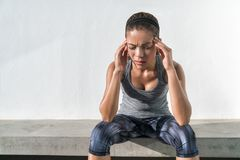 Athlete fitness woman with headache migraine pain. Athlete fitness running woman with headache migraine pain during cardio workout run. Asian athlete with health stock image