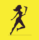 Athlete with flame. Silhouette of women with torch Royalty Free Stock Photography