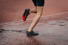Athlete foot running steeplechase. Athlete foot men running steeplechase. a spray of water Stock Image