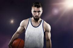 Athlete with football. Athletic young man with football  and sport dress Royalty Free Stock Images