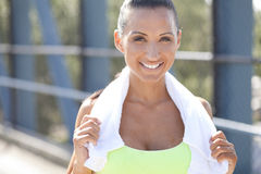 Athlete with friendly smile. A jogger with a towel around her neck and a friendly smile Royalty Free Stock Image