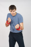 Athlete fulfills punches with the weighting Stock Image