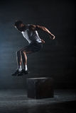 Athlete gave exercise. Jumping on the box. Phase Royalty Free Stock Images