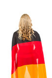 Athlete with german flag wrapped around his body. Athlete posing with german flag wrapped around his body on white background Stock Photography