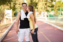 Athlete getting a kiss from his girlfriend Stock Image