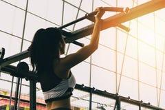 Athlete girl doing chin-ups training royalty free stock image