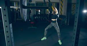 Athlete girl doing deep pull-ups on trx cables in sports gym `premium gym`. Ukraine Lviv 15.03.2020