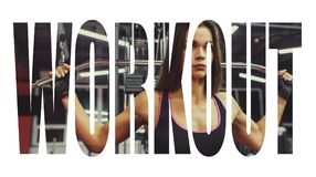 Athlete girl in sportswear working out and training her arms and shoulders with exercise machine in gym. Motivation sign. Royalty Free Stock Photo