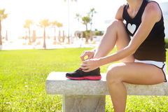 Athlete girl trying running shoes getting ready for jogging Royalty Free Stock Photo