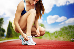 Athlete girl trying shoes Royalty Free Stock Image
