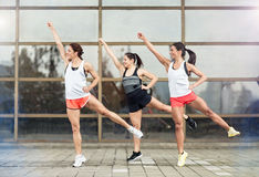 Athlete girls exercises outdoor Royalty Free Stock Photo