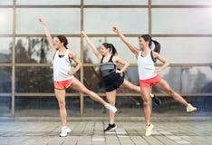 Athlete girls exercises outdoor Royalty Free Stock Photo