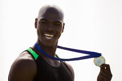 Athlete with gold medals around his neck Stock Images