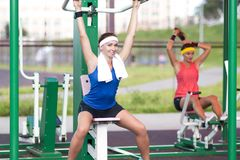 Athlete in good fit having training outdoors. one is staring straight at camera. Sport Concepts.Two Positive Caucasian Female Athlete in Good Fit Having Training Royalty Free Stock Photography