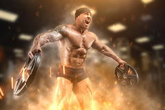 Athlete in the gym. Angry athlete trains in the gym Stock Photo