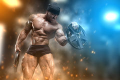 Athlete in the gym. Angry athlete trains in the gym Royalty Free Stock Photography