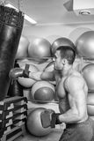 The athlete in the gym. Exhausting classes. Work on your body. Sophisticated power exercises. Photos for magazines, posters, backdrops and websites Stock Photo