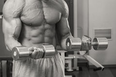 The athlete in the gym Royalty Free Stock Photos
