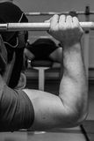The athlete in the gym Royalty Free Stock Image