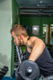 The athlete in the gym Stock Photography
