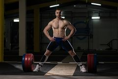 Young Athlete Getting Ready for Weight Lifting Training. Athlete in the Gym Is Prepared to Perform an Exercise Deadlift stock images