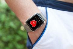 Athlete hand with watch and app health on the screen Stock Photos
