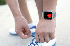 Athlete hand with watch and app health on the screen Stock Images