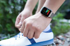 Athlete hand with watch and app training on the screen Stock Photos