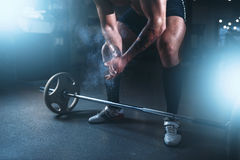 Athlete hands in powder and talc, barbell exercise Royalty Free Stock Images