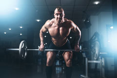 Athlete hands in powder and talc, barbell exercise Stock Photography