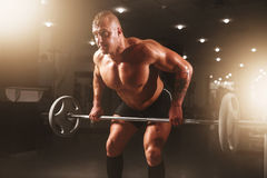 Athlete hands in powder and talc, barbell exercise Royalty Free Stock Photography
