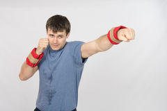 The athlete has his left hand with the weighting agent Stock Image