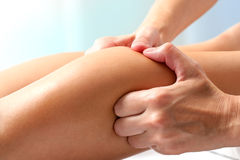 Athlete having therapeutic calf muscle massage. Stock Photography