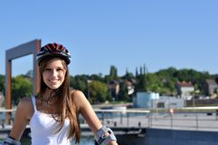 Athlete with helmet. Young Athlete with her helmet Stock Image