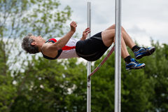 Athlete in high jump Royalty Free Stock Image