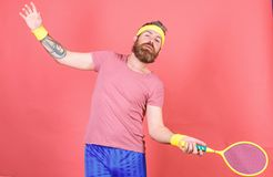 Athlete hipster hold tennis racket in hand red background. Man bearded hipster wear sport outfit. Having fun. Tennis. Active leisure. Tennis player vintage stock photo
