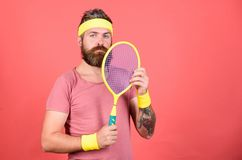 Athlete hipster hold tennis racket in hand red background. Play tennis for fun. Man bearded hipster wear sport outfit. Reach top again. Tennis player retro royalty free stock photo