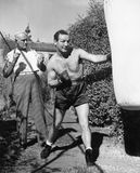 Athlete with his trainer working on a punching bag Stock Image