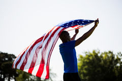 Athlete holding an american flag Royalty Free Stock Photo