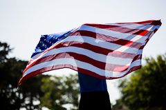 Athlete holding an american flag Stock Image