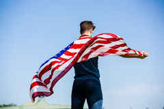 Athlete holding an american flag Royalty Free Stock Photos