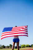 Athlete holding an american flag Stock Photography