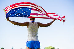 Athlete holding an american flag Royalty Free Stock Photography
