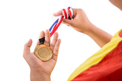 Athlete holding gold medal with ribbon on his hand Royalty Free Stock Photography