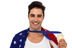 Athlete holding gold medal after victory Stock Photography