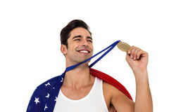 Athlete holding gold medal after victory Royalty Free Stock Image