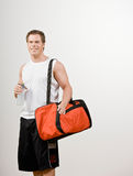 Athlete holding gym bag and water bottle Stock Photos