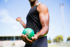 Athlete holding hammer throw. Mid section of athlete holding hammer throw in stadium royalty free stock image