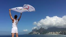 Athlete Holding Olympic Flag Rio de Janeiro stock video
